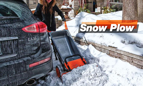 A Snow Plow attachment for the Worx Aerocart pushing some snow at ease